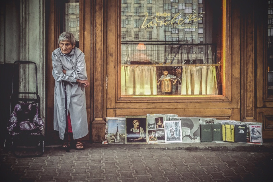 """V2 color """"Old woman selling art books on the  street""""  #streetphotography #emotions #people"""