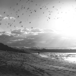 beach meteors sun fireball water