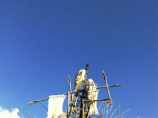 scarecrows blue sky